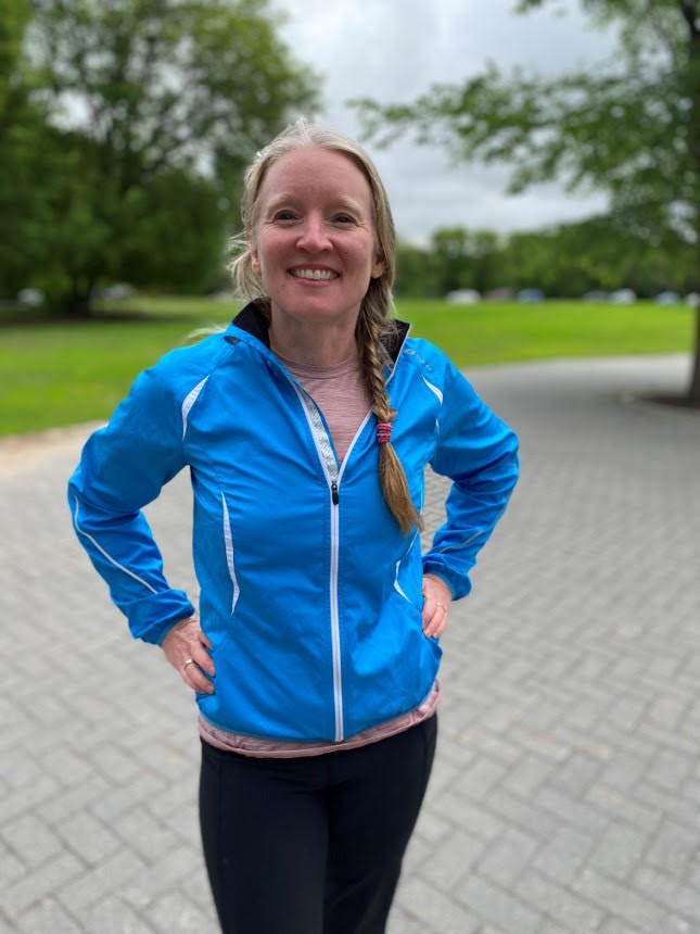 Aileen Hunt stands outside wearing a blue jacket.